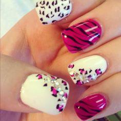 Plum zebra and cheetah nails with diamond stickers on them