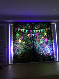 Using our battery operated up lights set to UV to light up this creative backdrop Outdoor Parties, Outdoor Events, Strobing, Battery Operated, Outdoor Lighting, Light Up, Color Change, Building A House, Backdrops
