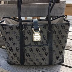 Dooney & Bourke Lg Satchel Tote! WOW! Amazing condition! One slight scratch on hardware I couldn't quite capture. Very clean. Side snaps don't hold very firm imo. Measures 9.5 inches tall, 5 inches with and 13 inches across. Nice size bag!!  Dooney & Bourke Bags Satchels