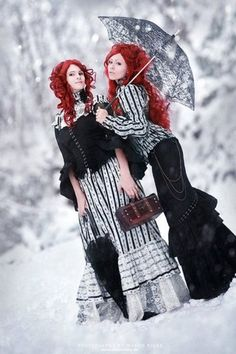 Beautiful frocks, amazing hair. Pretty sure being Bellatrix LeStrange and Narcissa Malfoy would be incredible for Halloween! @Janiece Stromberg @Jill Adams @T Love