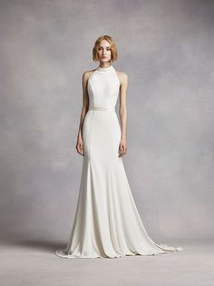 The high neckline on White by Vera Wang's halter wedding dress gives way to a striking T-back. Exclusively at David's Bridal.