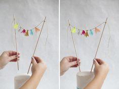 What fun!  DIY | tissue tassel garland cake topper