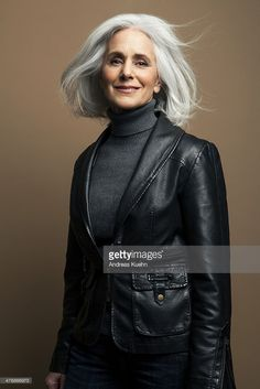 Stock Photo : Grey haired mature woman in leather jacket.