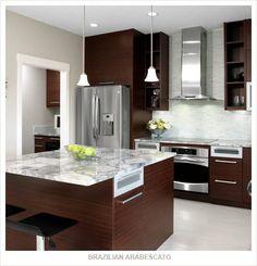 light countertops, light flooring, dark cabinets