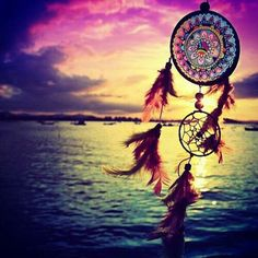 Mandala dreamcatcher feathers sunset beach