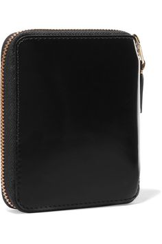 Black glossed-leather (Cow) Zip fastening along top and sides Made in Spain
