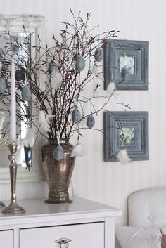 "slate colored eggs (+ frames) - love the idea of painting (spray paint, acrylic paint or the traditional way) eggs to match the rest of your home decor especially if it's a muted color that makes your ""Easter egg tree"" look this classy."