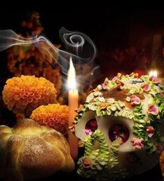 """In Mexico The """" Dia De Los Muertos """" celebration (Day of the Dead),is to honor the memory of the beloved ones that have past away.. we offer them their favorite food, drinks, some Pan de Muertos (or """"Bread of the Dead"""") is a traditional bread which is baked and eaten during this celebration, candy, toys and marigold flowers (Zempoalxóchitl), which help in color and smell trace the routes the dead."""