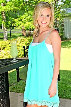 Lace trimmed tunic style blouse or dress with adjustable straps. Laken is wearing a size Small. (100% Polyester)