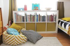 Aesthetically pleasing storage for a kids room. Black, white, and mustard color scheme too!