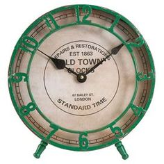 """Vintage inspired table clock with an openwork design and green finish.  Product: ClockConstruction Material: Metal and glassColor: Green Accommodates: Batteries - not included Dimensions: 10.25"""" H x 10"""" W x 6"""" D"""