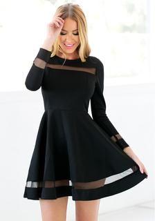 Pretty model wearing black mesh panel skater dress