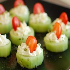 STUFFED CUCUMBER BITES 2 cucumbers sliced ¾ inch thick and hollowed with a melon baller 8 oz block cream cheese 2 tbsp mayonaise 2 tsp Ranch dressing mix ¼ tsp salt Halved grape tomatoes Finger Food Appetizers, Yummy Appetizers, Appetizers For Party, Finger Foods, Appetizer Recipes, Cucumber Appetizers, Cucumber Bites, Healthy Snacks, Healthy Recipes