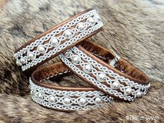 Sami Bracelet YDUN Bronze Lambskin Nordic Tundra Lapland Bracelet with Sterling Silver Beads - Handcrafted Natural Tribal Elegance from Tjekijas Design. Viking Bracelet, Viking Jewelry, Handmade Leather Jewelry, Bronze, Braided Leather, Bracelets, Beaded Jewelry, Jewelry Making, Textiles