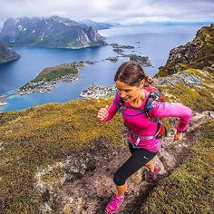 Welcome to #RunnerLand  #Photo:  @brianmccurdyphotography  The views we have seen running here in the Lofoten Islands have been unbelievable to say the least! Sasha running one of the many thin ridge lines we've come across. A view of Reine from Reineberingen. #AlpineRunning