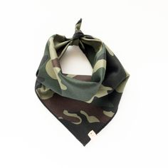 ARNOLD. Dog bandana or baby bib in green camo with black trim. Sizes: XS - XL. For the pooch or baby with a tough streak. We love camouflage on our pups! $26.