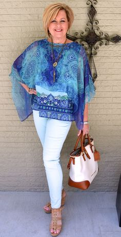 I have so many of these sheer tops.  Great with white ankle length jeans, tan wedge sandles.  Nice necklace!