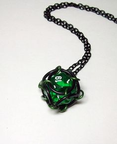 I love making jewelry with dice :)  This D20 is trapped in a chainmaille cage and comes on a necklace chain or keychain, whichever you prefer. You can choose the length of the chain to be anywhere bet
