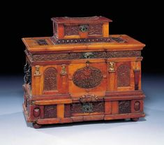 A METAL-MOUNTED AMBER CASKET. Circle of Georg Schreiber (active 1616-43) and later. 8¼ in. (21 cm.) high; 9¼ in. (23.5 cm.) wide; 55/8 in. (14.2 cm.) deep. Of architectural form and made of opaque and transparent amber, the body decorated with panels carved in relief with scrolling foliage, fruit, and fantastical grotesque figures. (ex Batsheva de Rothschild). -Christie's- Furniture Near Me, Vintage Furniture, Furniture Design, Old Boxes, Antique Boxes, Clear Coffee Mugs, Art Cabinet, Luxury Furniture Stores, Japanese Furniture