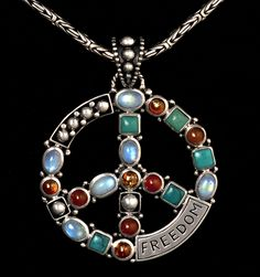Sterling Silver Peace Sign Necklace with Rainbow Moonstones, Tibetan Turquoise, Baltic Amber & Carnelian, handcrafted in Bali by Bluemoonstone Creations.