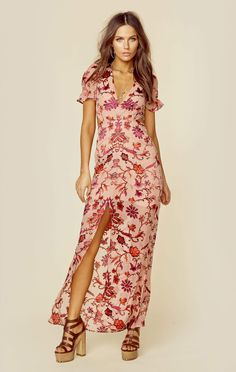 """For Love and Lemons gives you the Saffron Maxi Dress. Featuring a plunging neckline, bold back cutout, floral embroidery throughout, and front slit.   ImportedDry Clean OnlyPoly ChiffonFit Guide:Model is 5ft 7 inches; Bust: 32"""", Waist: 24"""", Hips: 34""""Model is wearing a size XSRelaxed FitShoes Featured Not Available For Purchase"""