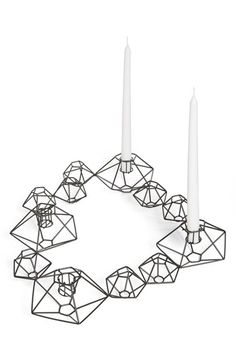 Add a contemporary vibe to your living space with this great candle-holder!