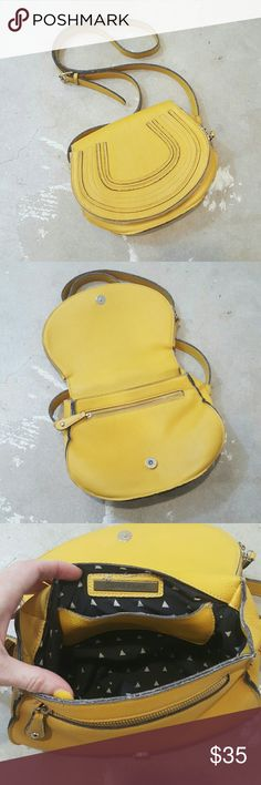 Urban Outfitters Crossbody Saddle Bag I am selling an cool and edgy Street Level (Urban Outfitters) crossbody, saddle bag.  This is such a fun and vibrant, yellow/gold color in a fun shape.  I bought the bag and it featured a bit of a raw edge look, that has only been amolified with wesr however I also think it ads to it's design wonderfully.  Add some  color and edginess to your summer style!  Interior is in great condition!! Urban Outfitters Bags Crossbody Bags
