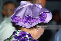 Queen Elizabeth Ll Wearing A Mauve Straw Hat Decorated With Violets Designed By Milliner Philip Somerville During Her Official Tour Of Singapore.  (Photo by Tim Graham/Getty Images)