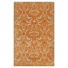 """Anchor your living room seating group or define space in the den with this artfully hand-tufted wool rug, featuring a damask-inspired motif for eye-catching appeal.  Product: RugConstruction Material: WoolColor: Orange and ivoryFeatures:  Hand-tuftedPlush pilePile Height: 0.4"""" Note: Please be aware that actual colors may vary from those shown on your screen. Accent rugs may also not show the entire pattern that the corresponding area rugs have.Cleaning and Care: Vacuum regularly. Blot ..."""