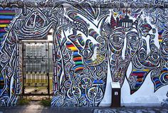 The longest remaining stretch of the Berlin Wall today operates as an open air art gallery that serves as a monument to the fall of Communism. Nearly a mile long, it's home to over 100 inspiring murals, each depicting hope for a better future and the joy of overcoming Europe's Iron Curtain. A group of international artists created the gallery in 1990 and today it's one of Berlin's most visited monuments.   - PopularMechanics.com