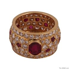 """Cartier ruby and diamond 18K gold bandring from the """"Panthere"""" collection, with presentation box.  France, circa. 1980s."""
