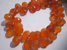 8 inch dark carnelian 7x11mm  faceted briolettes beads one strand