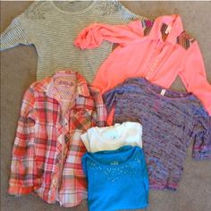 Girls 10/12 Bundle Button up flannel. Button up sheer coral blouse. Grey striped scoop beck light weight sweater. Purple and pink 3/4 sleeve top. 2 long sleeve Justice tees. Most worn once. A couple never worn. Tops