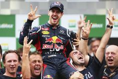 Sebastian Vettel of Germany and Red Bull Racing celebrates with team mates on the podium as he finishes in sixth position and clinches the drivers world championship during the Brazilian Formula One Grand Prix Alain Prost, Jackie Stewart, Red Bull Racing, F1 Racing, Fc Barcelona, Grand Prix, Red Bull Media House, Gp Formula, Ferrari F1