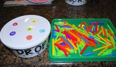 """Color Drop"" which reinforces/teaches colors, and improves visual discrimination and fine motor skills. make this using straws and a used whipped cream topping. You can use a variety of containers to make this game, but you will want something with a plastic lid."