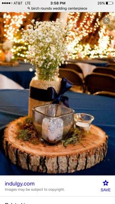 Navy tablecloth with a birch round centerpiece