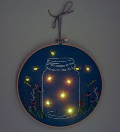 Nightlight Embroidered Wall Art/ would be nice too through ancient lace/embroidery/DB Nightlight Embroidered Wall Art I'm thinking larger scale painting with the lights! Need to see if this can be done in cross stitch? Nightlight Embroidered Wall Art by T Embroidery Hoop Crafts, Embroidery Art, Cross Stitch Embroidery, Embroidery Patterns, Cross Stitch Patterns, Art Textile, Cross Stitching, Fiber Art, Needlework