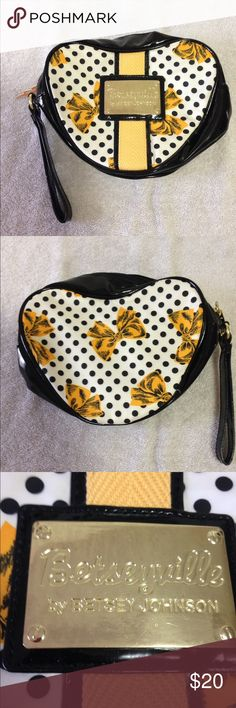 "Betseyville Wristlet Over-sized super cute Betseyville wristlet....black, white, & bright yellow w/black dots & happy yellow bows! Could be used as a purse, wristlet, or makeup bag....it's huge! 9"" W x 8"" T x 3"" D! It has been gently used a couple of times, but you can hardly tell. Give this stunning lady a home! (Please pardon shadow on left side of pic...it's my kitchen, not a stain on the white!) Betsey Johnson Bags Clutches & Wristlets"