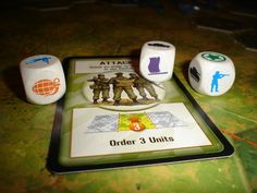 Memoir 44 dice. Rolling the various symbols will either eliminate and enemy unit type or cause them to retreat in the case of the flag. Grenede symbols eliminate both tanks and troops. Stars may eliminate units if they come up during air attacks or on other occasions when indicated on a special orders card.