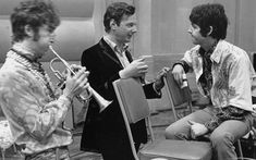Brian Epstein with John Lennon and Paul McCartney Photo: DAVID MAGNUS/Rex Features