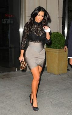 Loving this outfit!...Kim K. in Bebe (skirt) and  H & M (top).