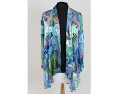Stunning blue and green print jacket. Elegant and cool with long sleeves. Wear simply with a coloured camisole and trousers for a fab look. Now only available in a size 24 at www.middeltonwood.co.uk