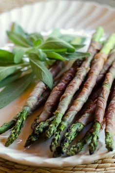 Grilled asparagus with prosciutto is an easy paleo appetizer. It's the perfect thing to make when you're grilling the main course.    cookeatpaleo.com