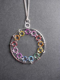 Rainbow Chainmaille Necklace... I think continuing this to the center, making a dream catcher like design would be cool
