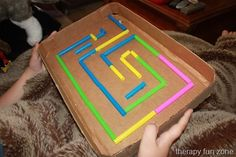 "Here is a low tech visual perceptual marble maze made out of a cardboard box and some straws. This one is fairly simple, but it can be useful for those who have trouble with motor coordination as well as visual perception. I used a cardboard box and some large ""Smoothie Straws"". I glued the straws in place using a warm melt glue gun. It is not a difficult maze to get through, but works on visual tracking and visual motor  {Read More}"