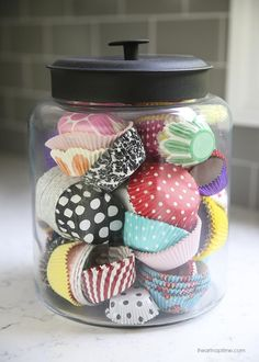 Cupcake liners in jar -cute and simple way to add color to the kitchen!