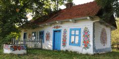 All The Buildings In This Small Village Are Covered In Paintings Of Flowers  - CountryLiving.com