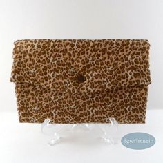 Leopard Print Trifold Wallet, Fabric Clutch Walk on the wild side and stay organized with this fabric wallet or clutch made of brown mini leopard print cotton fabric. Features include: