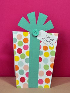 This cute birthday card is shaped like a birthday present // by Tiddleywinks Designs