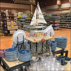 A power aisle island allowed for this Nautical Tableware Display Stern View. The bow view offers initial engagement, but the stern has items to offer too Visual Merchandising Displays, Plate Display, Ceramic Tableware, Hanging Chair, Close Up, Nautical, Plates, Ceramics